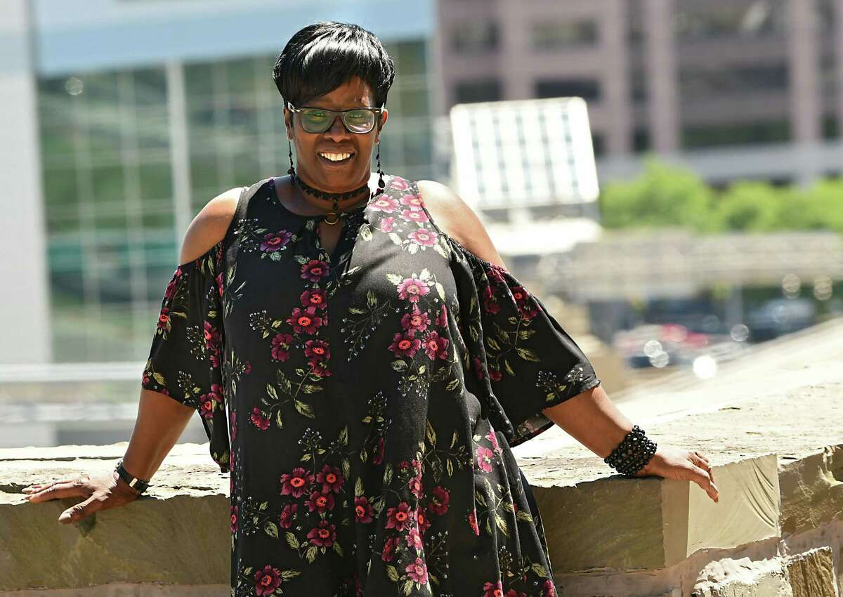 Sandra McKinley stands outside the building she works on Thursday, July 19, 2018 in Albany, N.Y. McKinley is the founder of DIVA's, a Christian organization that stands for ODivinely, Inspired, Victoriously, Assigned sister.O (Lori Van Buren/Times Union)