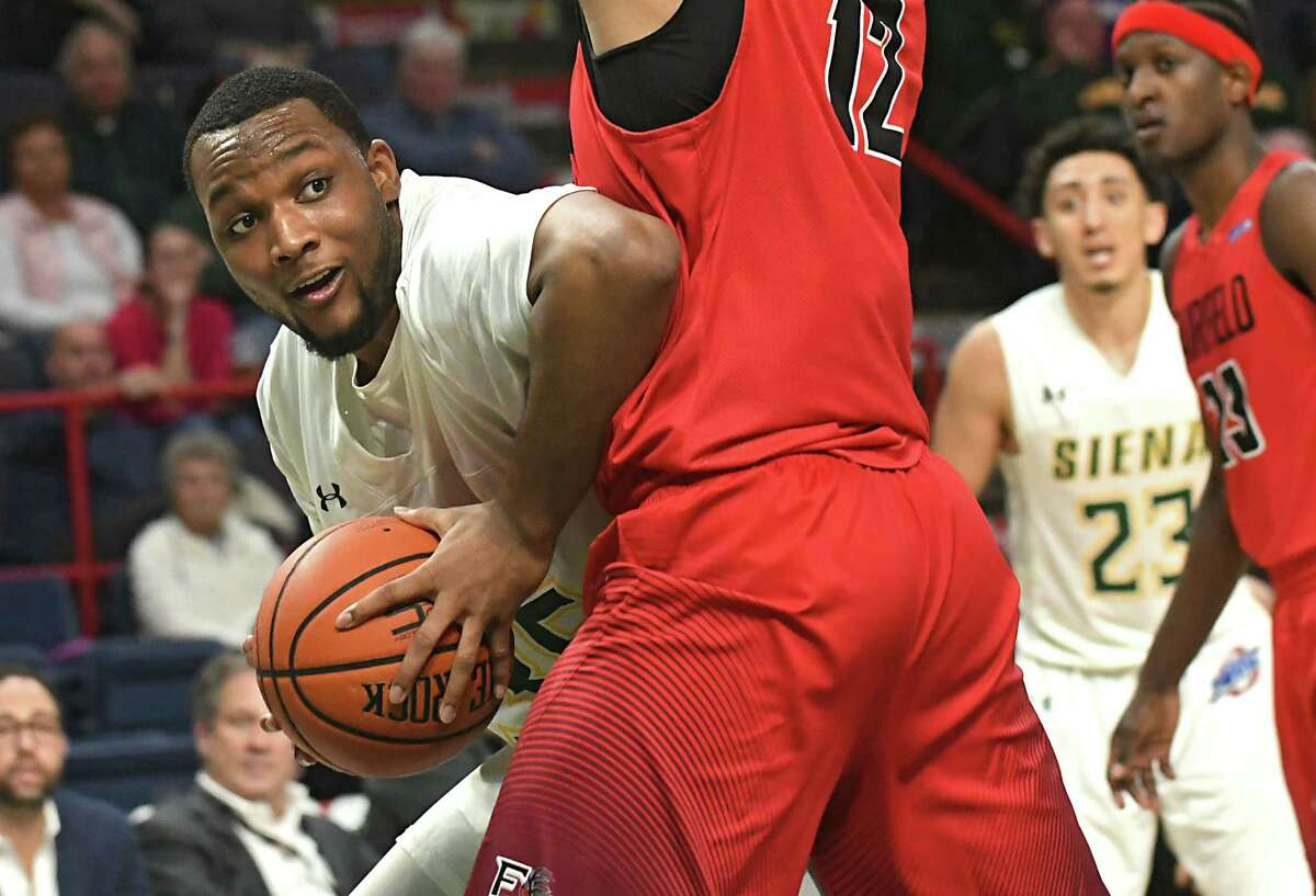 Siena's Sammy Friday gets by Fairfield's Kevin Senghore-Peterson during a basketball game at Times Union Center on Wednesday, Feb. 21, 2018 in Albany, N.Y. (Lori Van Buren/Times Union)