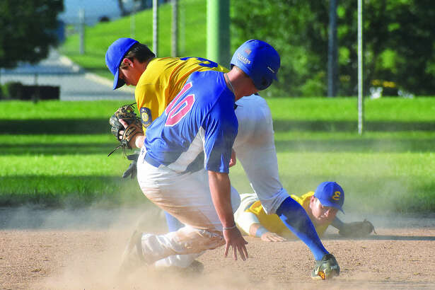 Edwardsville Post 199 infielder Joel Quirin forces out a runner at second base after receiving a flip from Tate Wargo, backgrond, during the District 22 championship game against Belleville at Hoppe Park.