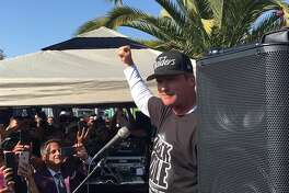 Raiders head coach Jon Gruden addresses the crowd at a fan appreciation event at Ricky's Sports Theatre and Grill in San Leandro, Calif., on Friday, July 20.