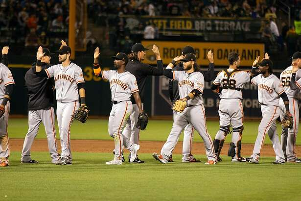 San Francisco Giants celebrate their victory over the Oakland Athletics in a Major League Baseball game, Friday, July 20, 2018 in Oakland, Calif. The Giants won 5-1.