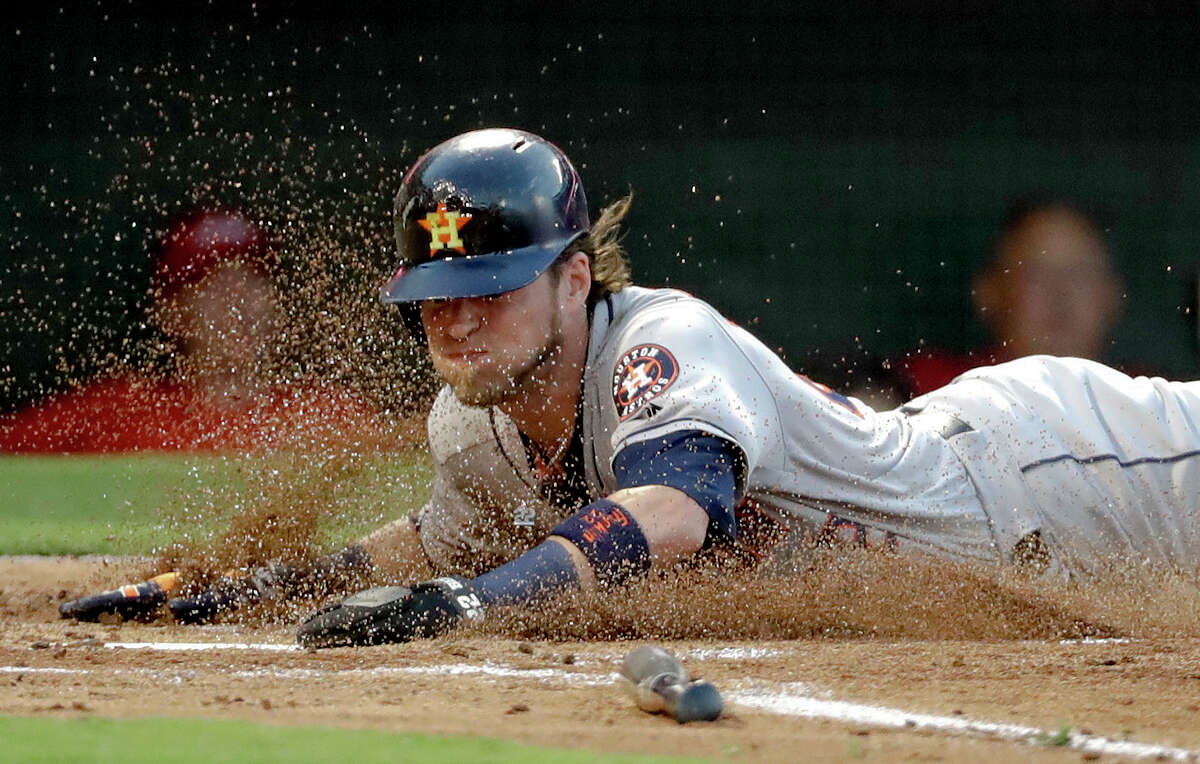 Houston Astros' Josh Reddick scores on a sacrifice fly by George Springer during the second inning of a baseball game against the Los Angeles Angels in Anaheim, Calif., Friday, July 20, 2018. (AP Photo/Chris Carlson)