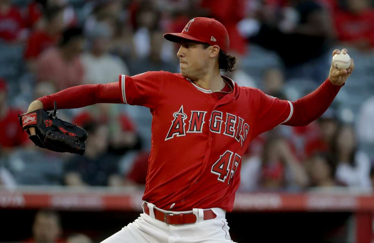 Los Angeles Angels starting pitcher Tyler Skaggs throws against the Houston Astros during the first inning of a baseball game in Anaheim, Calif., Friday, July 20, 2018. (AP Photo/Chris Carlson)