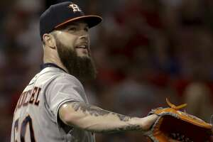 Houston Astros starting pitcher Dallas Keuchel smiles after Los Angeles Angels' Mike Trout fouled out during the fourth inning of a baseball game in Anaheim, Calif., Friday, July 20, 2018. (AP Photo/Chris Carlson)