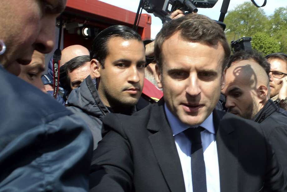 Bodyguard Alexandre Benalla (center left) accom pa nies French leader Emmanuel Macron in 2017. Photo: Thibault Camus / Associated Press 2017