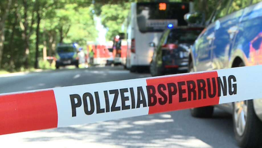 Police tape in Luebeck in northern Germany marks where a man attacked bus passengers Friday. Photo: AFP / Getty Images