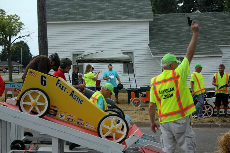 The competition was stiff at the annual American Legion Cart Derby in Harbor Beach Saturday. Despite light rain, crowds gathered to watch numerous carts race down the hill near the American Legion Hall. Photo: Brenda Battel/Huron Daily Tribune