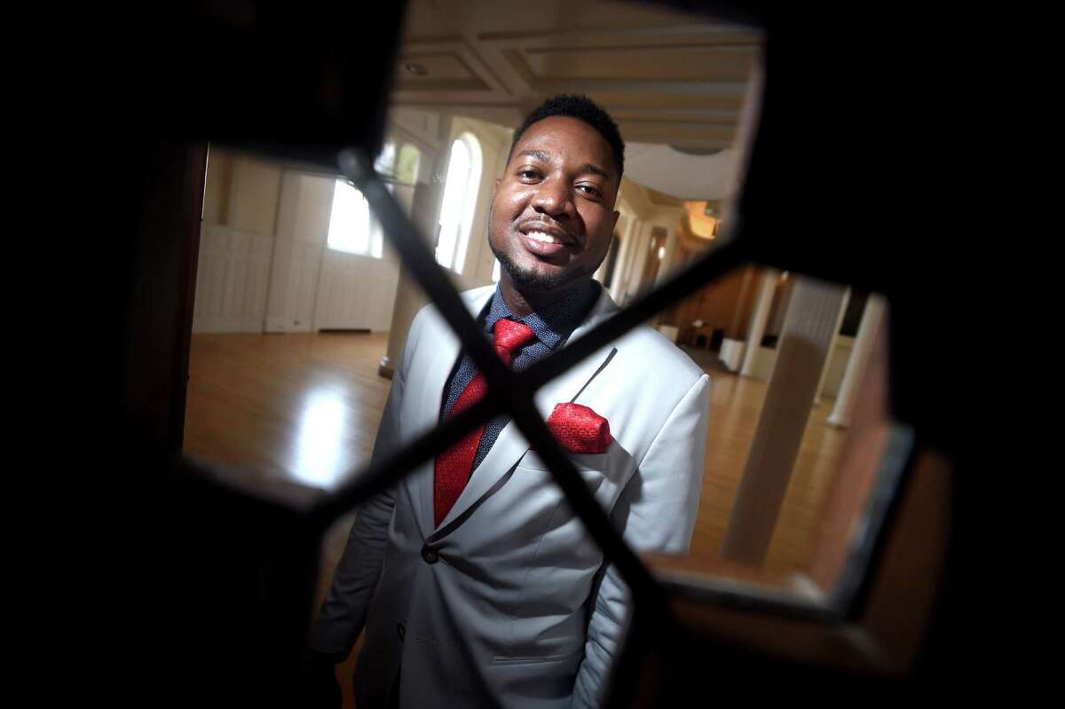 The Rev. Herron Gaston, associate director of admissions at Yale Divinity School, is photographed at Marquand Chapel in New Haven.