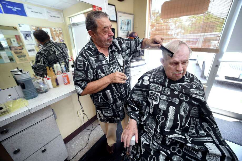 John Proto cuts the hair of Bill Burns of North Haven at Cosmo's Barber Shop in North Haven. Photo: Arnold Gold / Hearst Connecticut Media / New Haven Register
