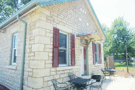 Heaton first bought Jeni J.'s Unique Gifts and Guesthouses Wilson's historic stone cottage — constructed of Mississippi River bluff limestone — at 120 W. Main St., and the former Two Rivers Winery building at 211 W. Main St., seen here. Heaton recently bought the remainder of Jeni J.'s Unique Gifts and Guesthouses' property, at 214 W. Main St., which includes four guesthouses and a specialty boutique.