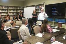 Kim Hess, founder of Cassidy Joined for Hope, and Ken Schlenker, director of chaplaincy programs atthe Grace School of Theology,speak to attendees of the community roundtable to discuss suicide prevention in The Woodlands on Wednesday, June 2, at the Grace School of Theology.