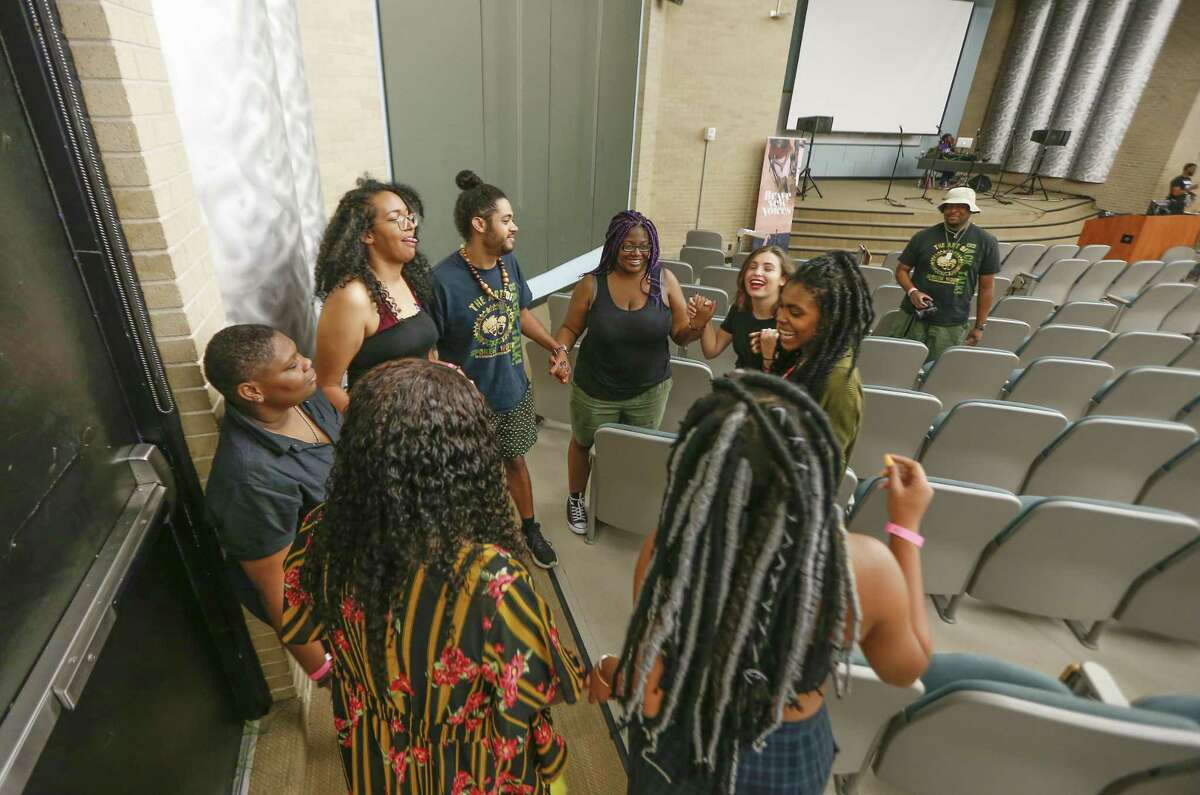 Team Tampa poets and advisors take a moment to reflect before performing at Brave New Voices competition Friday, July 20, 2018, in Houston. Brave New Voices is a slam poetry festival for young people running from July 18 to 21 at the University of Houston's campus. In addition to being a large slam poetry competition, attendees will get to participate in workshops and events that help them come to terms with issues of identity, LGBTQ+, and mental health through poetry. ( Steve Gonzales / Houston Chronicle )