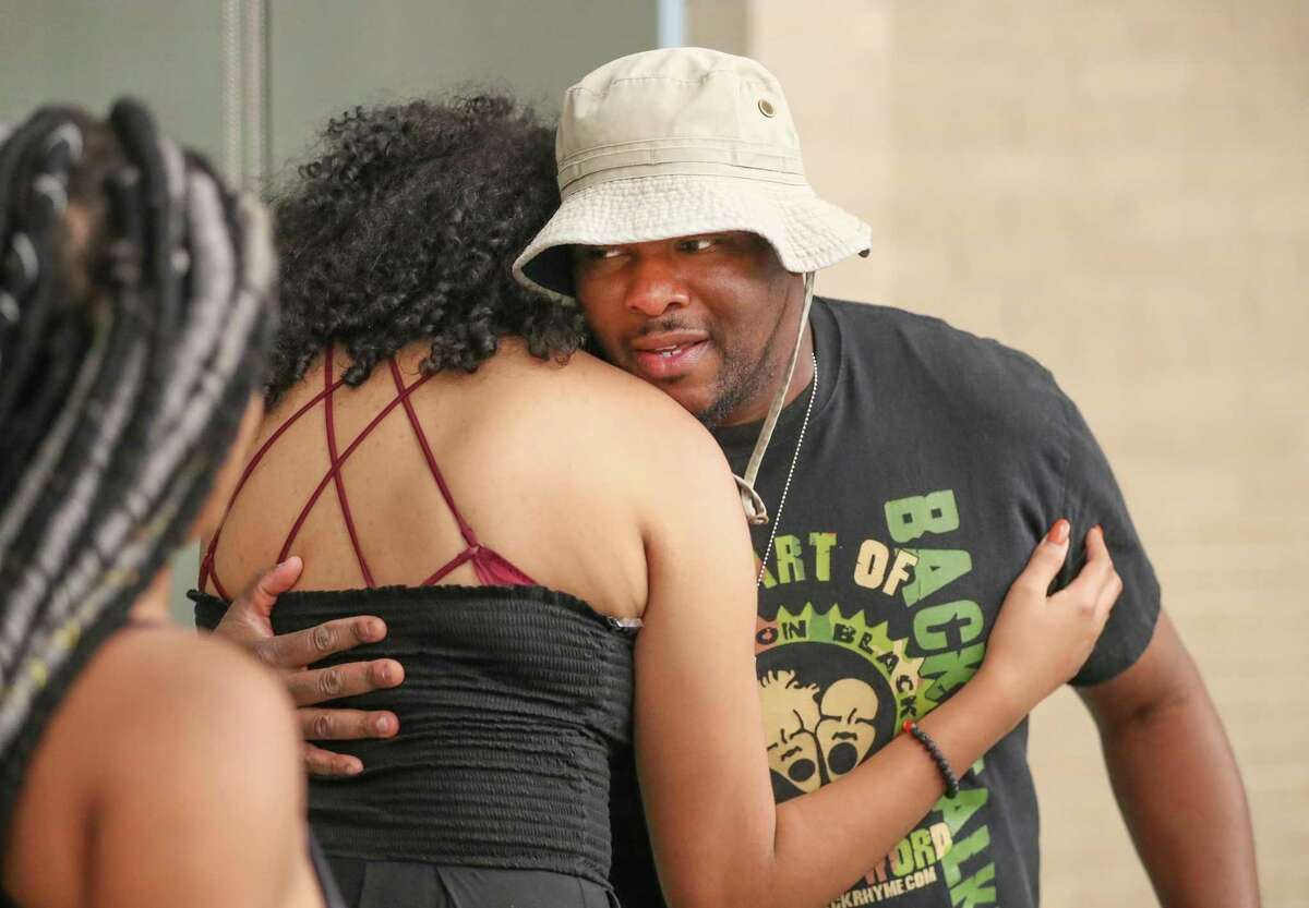 """Team Tampa advisor Walter """"Wally B."""" Jennings gives support to team members before performing at Brave New Voices competition Friday, July 20, 2018, in Houston. Brave New Voices is a slam poetry festival for young people running from July 18 to 21 at the University of Houston's campus. In addition to being a large slam poetry competition, attendees will get to participate in workshops and events that help them come to terms with issues of identity, LGBTQ+, and mental health through poetry. ( Steve Gonzales / Houston Chronicle )"""
