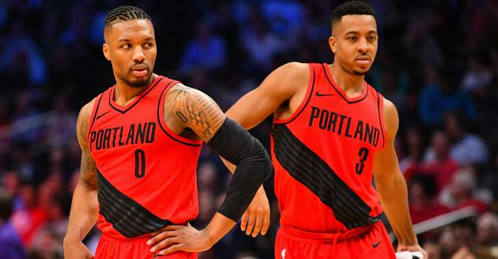 LOS ANGELES, CA - JANUARY 30: Portland Trail Blazers Guard Damian Lillard (0) and Portland Trail Blazers Guard CJ McCollum (3) look on during an NBA game between the Portland Trail Blazers and the Los Angeles Clippers on January 30, 2018 at STAPLES Center in Los Angeles, CA. (Photo by Brian Rothmuller/Icon Sportswire via Getty Images)