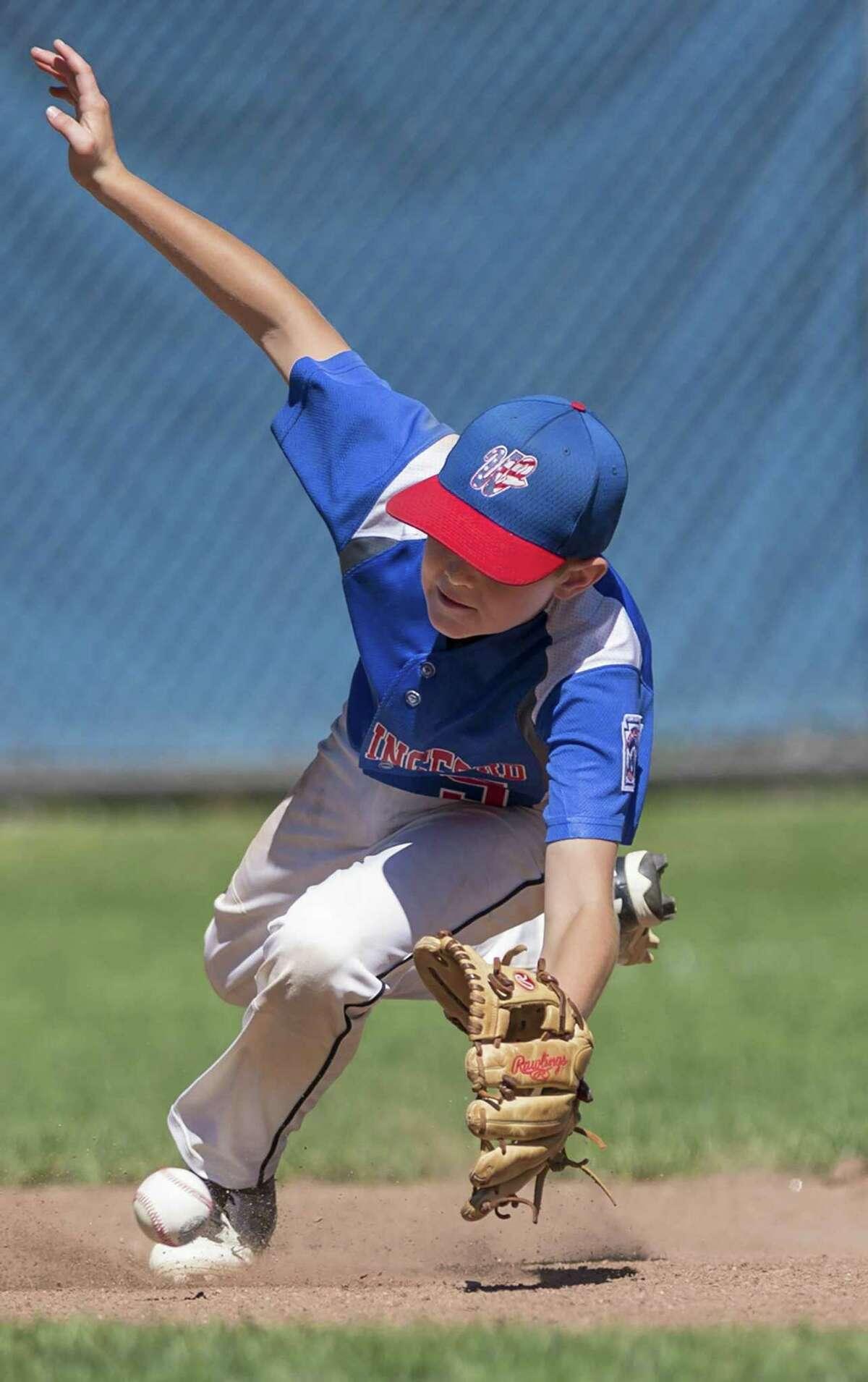 Wallingford shortstop Kyle Mitchell fields a ground ball.