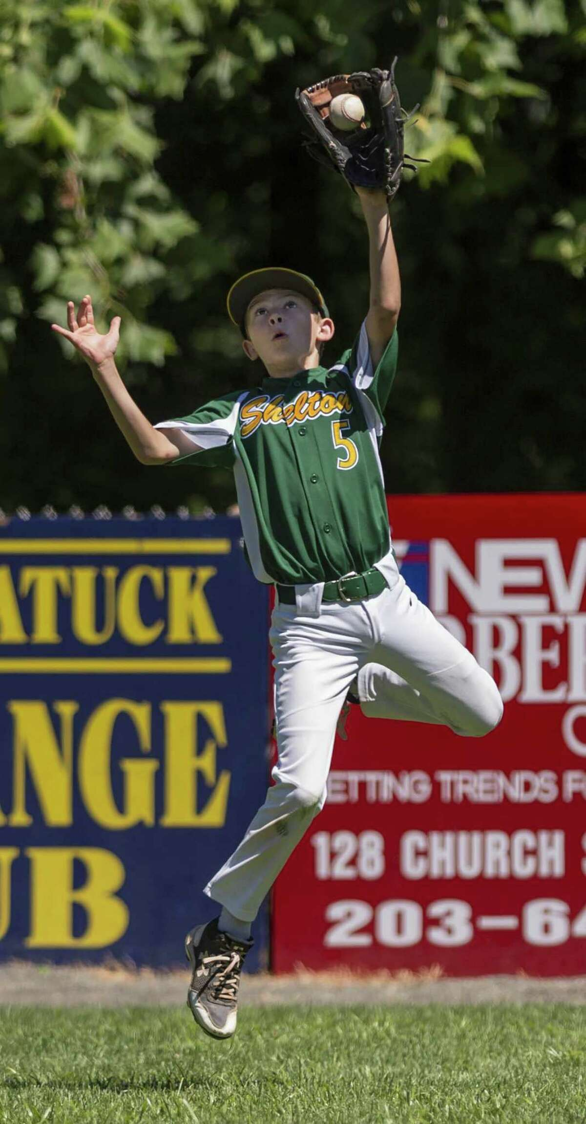 Shelton American center fielder Michael Spadaccino leaps to catch a fly ball during the district 2 Little League championship game against Wallingford played at Peter J. Foley Field, Naugatuck, CT. Saturday, July 21 2018.