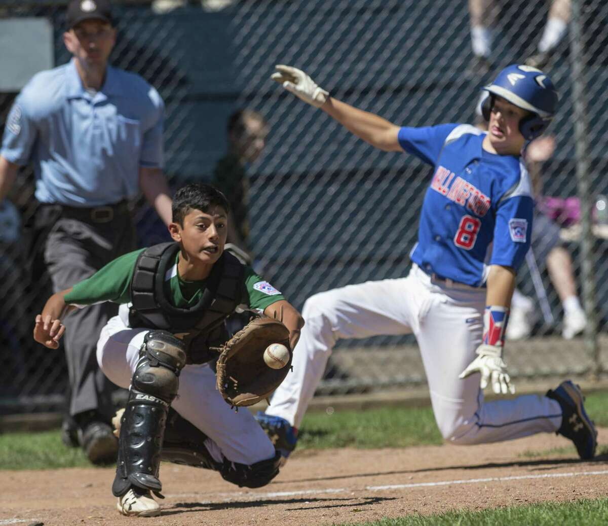 Wallingford?'s Jacob Morrison slides safely into home as the Shelton American catcher Nicolas Piscioniere readys to catch the throw to home during the district 2 Little League championship game played at Peter J. Foley Field, Naugatuck, CT. Saturday, July 21 2018.