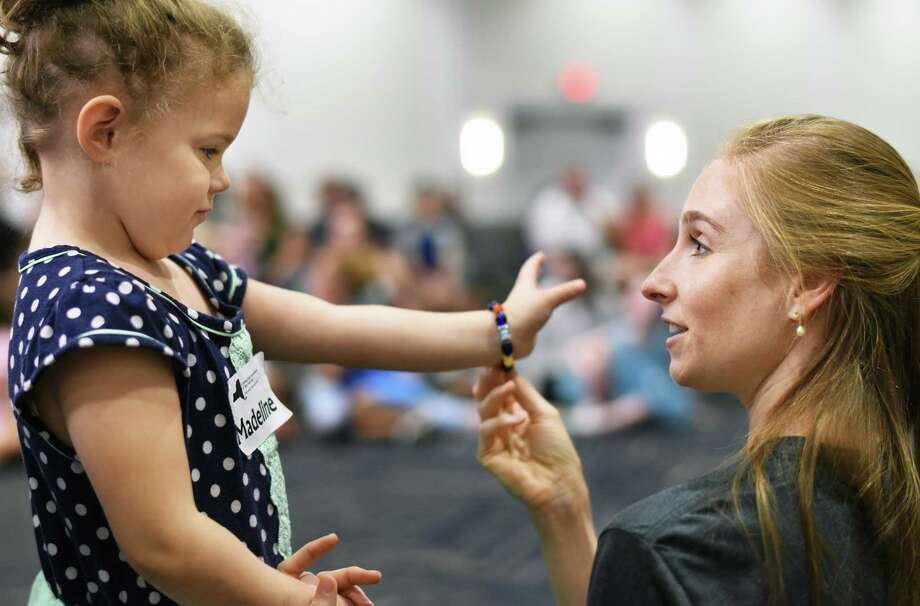 Four-year-old Madeline McMahon of Saratoga Springs gets some pointers from New York City Ballet soloist Ashley Laracey during a ballet workshop for children with disabilities Saturday July 21, 2018 in Saratoga Springs, NY.  (John Carl D'Annibale/Times Union) Photo: John Carl D'Annibale / 20044360A