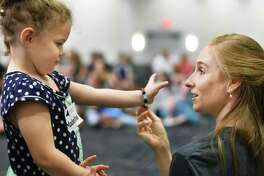 Four-year-old Madeline McMahon of Saratoga Springs gets some pointers from New York City Ballet soloist Ashley Laracey during a ballet workshop for children with disabilities Saturday July 21, 2018 in Saratoga Springs, NY.  (John Carl D'Annibale/Times Union)
