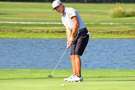 Former Edwardsville golfer Ben Tyrrell hits a putt during a regular season match last year for the Tigers.