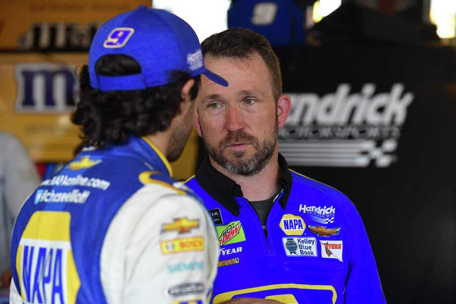 Norwalk native Scott Honan (facing, right) discusses the No. 9 Chevrolet's set-up with Hendrick Motorsports driver Chase Elliott. Photo: Nigel Kinrade Photography / NASCAR / Contributed Photo / Stamford Advocate Contributed