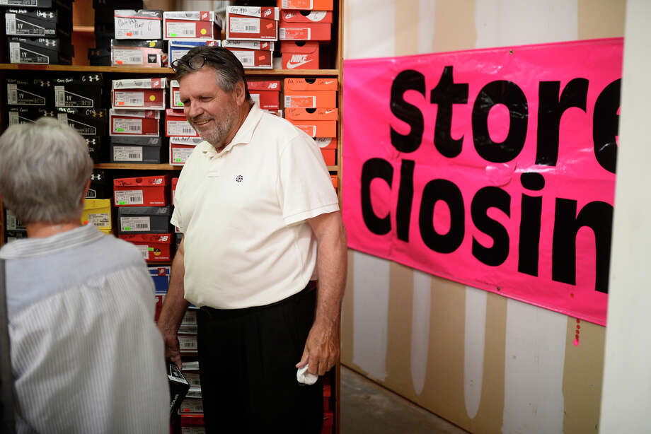 Terry Sevart, founder and former owner of Terry's Kids Shoes, chats with customers during a closing sale July 21, 2018. The Midland store underwent an ownership change in 2016 but has been open for 18 years. Sales will continue until all inventory is gone.  James Durbin/Reporter-Telegram Photo: James Durbin / ? 2018 Midland Reporter-Telegram. All Rights Reserved.