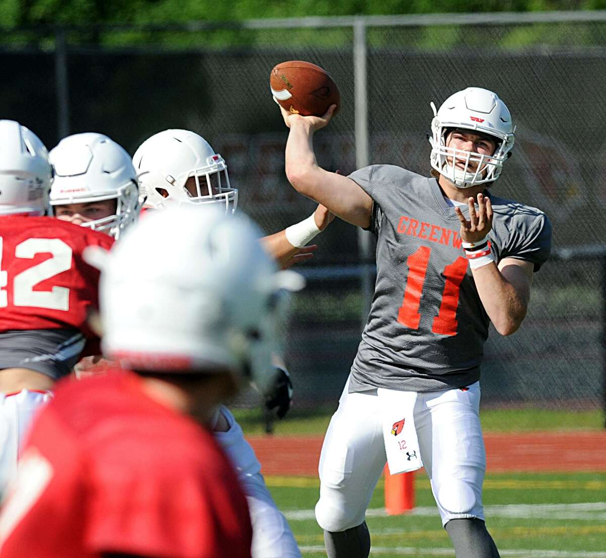 Greenwich quarterback Gavin Muir (#11) of the white team throws a pass during the annual Red vs. White Greenwich High School football scrimmage at Cardinal Stadium in Greenwich, Conn., Saturday, June 16, 2018.