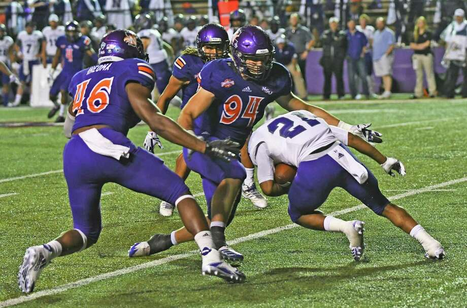 Northwestern State defensive end Zak Krolczyk, a graduate of The Woodlands High School, make a tackle during a game last season. Photo: Northwestern State Athletics