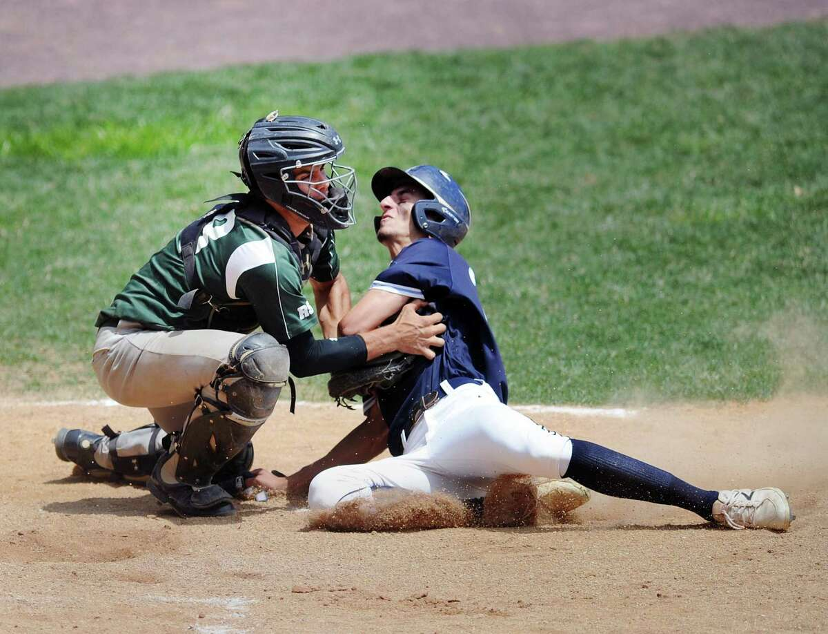 Guilford catcher Matt Donlan, left, tags out Adam Stone of Stamford Post 3 who was trying to take home in the bottom of the first inning of the American Legion playoff game between Stamford Post 3 and Guilford at Cubeta Stadium in Stamford, Conn., Saturday, July 21, 2018