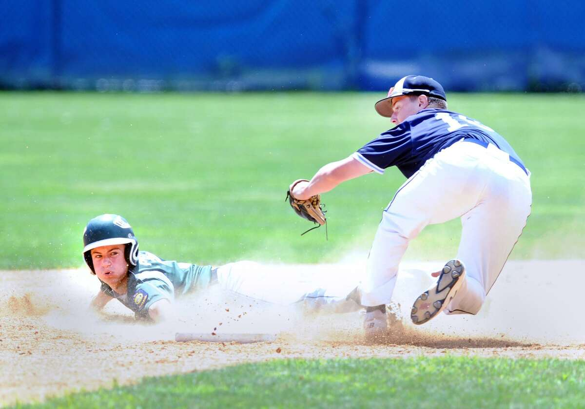 Leo Socci the second baseman for Stamford Post 3, right, tags out Guilford's John Petonito who was attempting to steal second base during the top of the first inning of the Senior American Legion playoff game between Stamford Post 3 and Guilford at Cubeta Stadium in Stamford, Conn., Saturday, July 21, 2018