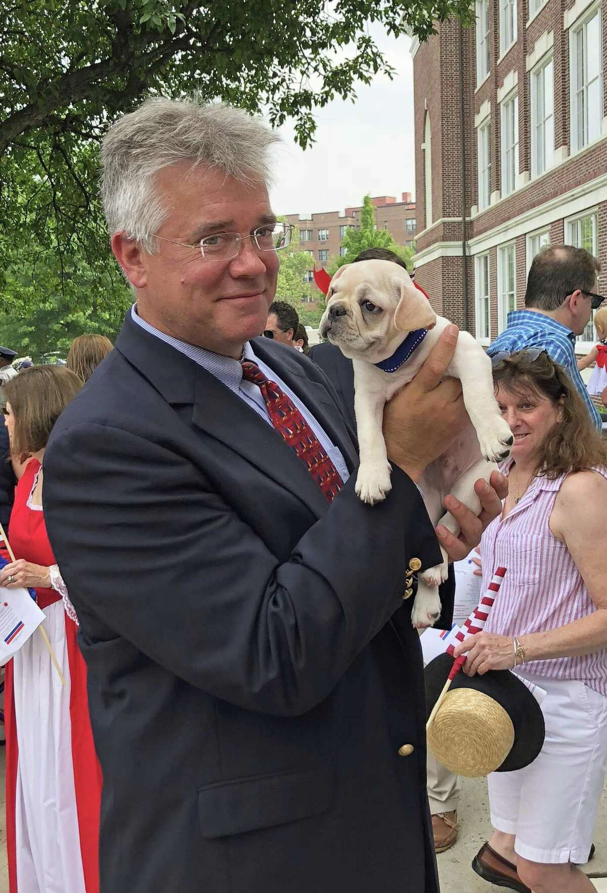 John Shaban, a former state representative from Redding, is running for the Republican nomination for attorney general. He held a dog while campaigning in Greenwich on July 4, 2018.