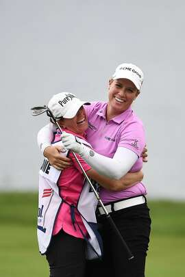 LEXINGTON, KY - JULY 21:  Brittany Lincicome celebrates an eagle with her caddie Missy Pederson on the 17th hole during a continuation of the second round of the Barbasol Championship at Keene Trace Golf Club on July 21, 2018 in Lexington, Kentucky.  (Photo by Stacy Revere/Getty Images)