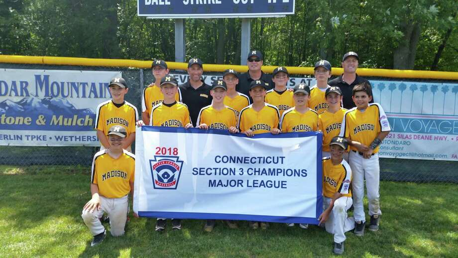 The Madison Little League team poses with the championship banner after winning the Section 3 championship on Saturday. Photo: Dan Nowak / Hearst Connecticut Media