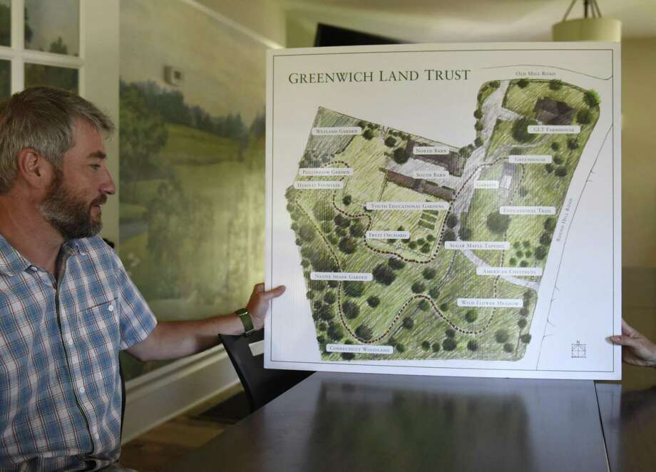 Greenwich Land Trust Executive Director Will Kies shows a map of the new accessible walking trail at the Greenwich Land Trust Mueller Preserve in Greenwich, Conn. Thursday, July 19, 2018. The new trail traverses four acres of land showing a variety of different habitats and ecosystems, a microcosm of those found throughout the town, over the short loop. Photo: Tyler Sizemore / Hearst Connecticut Media / Greenwich Time
