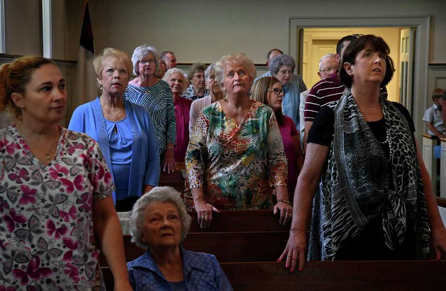 Congregants follow along with a projection of a Bible verse during a sermon at the First Baptist Church in Luverne, Alabama, by its pastor, Clay Crum, in his series on the Ten Commandments. Photo: Washington Post Photo By Michael S. Williamson / The Washington Post