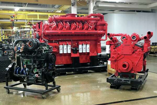 In its Seymour, Indiana, plant, Cummins Inc. produces a 95-liter engine, middle, that can power stadiums and hospitals. Only 10 can be made a day, and eight of those will be sold overseas.