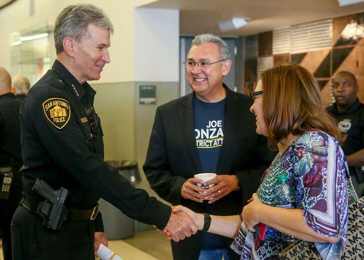 San Antonio Police Chief William McManus (from left) greets Bexar County district attorney candidate Joe Gonzales and Laura Barberena before hosting a public safety town hall Saturday in the Richard S. Liu Auditorium at UTSA.