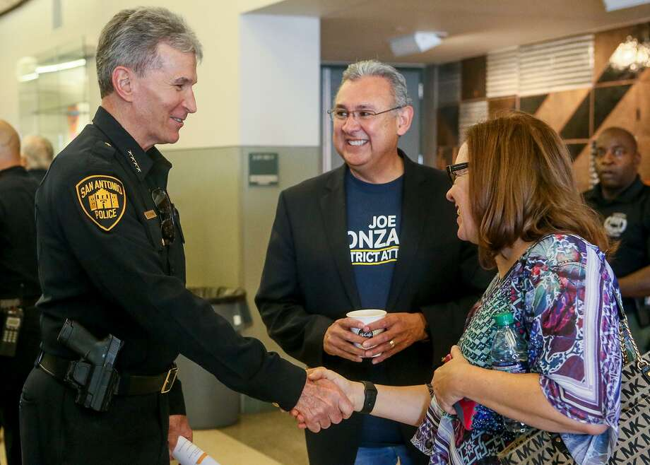 San Antonio Police Chief William McManus (from left) greets Bexar County district attorney candidate Joe Gonzales and Laura Barberena before hosting a public safety town hall Saturday in the Richard S. Liu Auditorium at UTSA. Photo: Marvin Pfeiffer /Staff Photographer / Express-News 2018