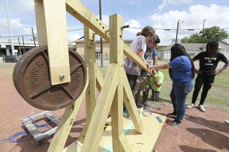 Advanced Learning Academy pre-calculus students prepare to launch a two pound ball across the Fox Tech football field in 2018 using a wooden trebuchet they designed and built. A teacher at the ALA on Monday became onw of 10 winners of the Outstanding Teaching of the Humanities Award. Photo: William Luther /San Antonio Express-News / © 2018 San Antonio Express-News