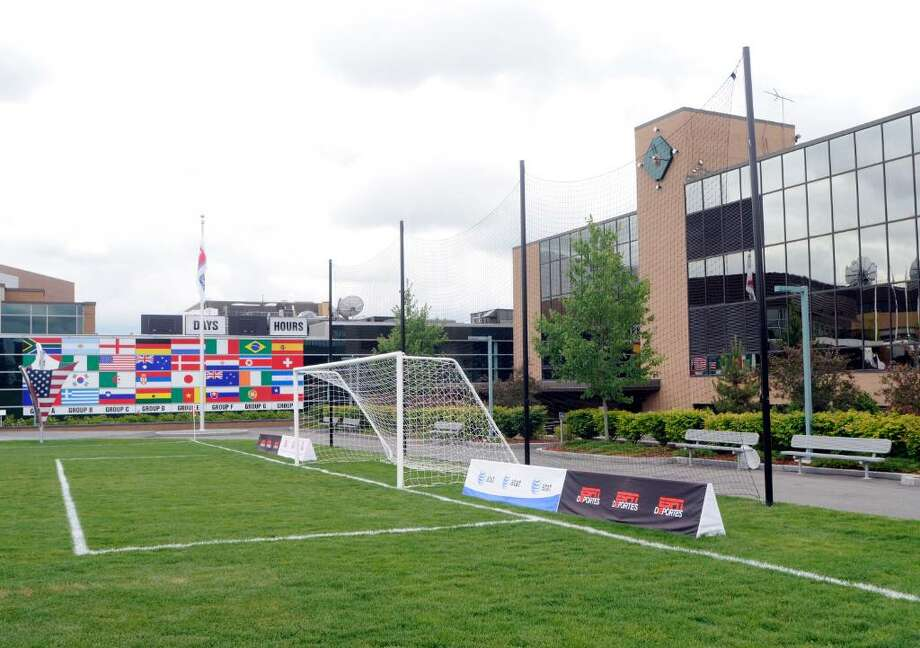 A soccer field on the ESPN corporate campus is decorated with the flags of the 32 World Cup teams before the start of the opening game in Bristol, Connecticut, U.S., on Friday, June 11, 2010. Walt Disney Co.'s ESPN network today launched a new 3-D sports channel in conjunction with the opening game of the 2010 World Cup. Photographer: Chris Ware/Bloomberg Photo: Chris Ware, Bloomberg