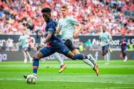 Paris Saint-Germain's Timothy Weah (L) vies for the ball with Bayern Munich's Josip Stanisic during their International Champions Cup football match Bayern Munich against Paris Saint-Germain (PSG) on July 21, 2018 at the Worthersee Stadium in Klagenfurt, Austria. / AFP PHOTO / Jure MakovecJURE MAKOVEC/AFP/Getty Images