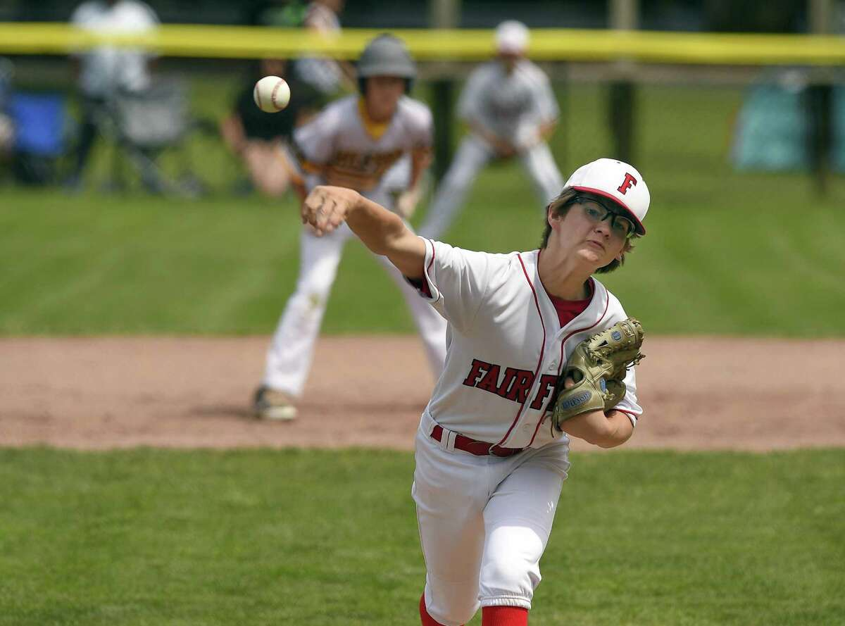 Fairfield American pitcher Pierce Cowles delivers against Milford during the first inning of a Section 1 Little League Championship at Drotar Park on July 21, 2018 in Stamford, Connecticut. Fairfield American defeated Milford 5-2.
