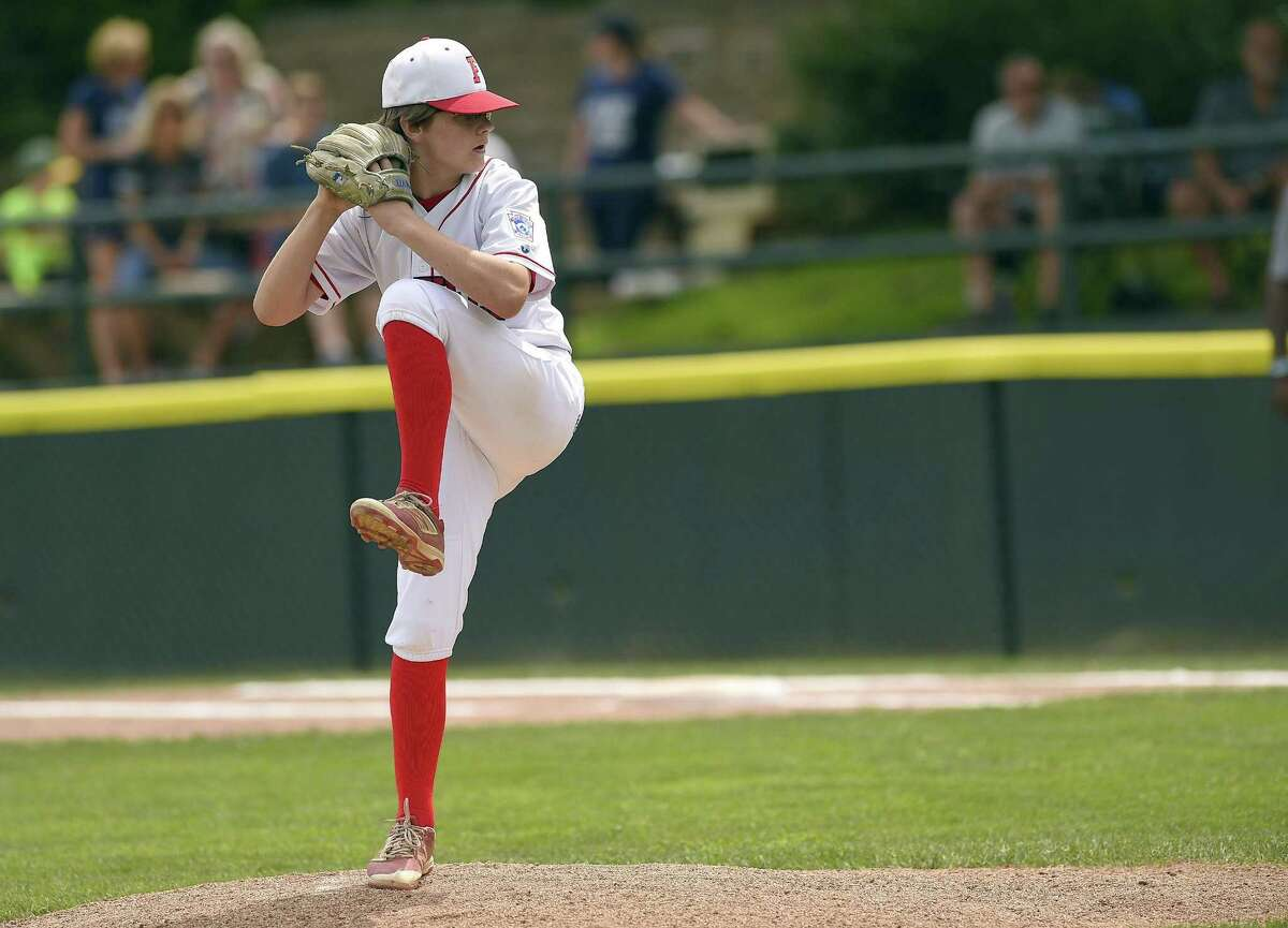 Fairfield American pitcher Pierce Cowles delivers against Milford during the second inning of a Section 1 Little League Championship at Drotar Park on July 21, 2018 in Stamford, Connecticut. Fairfield American defeated Milford 5-2.