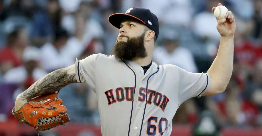Houston Astros starting pitcher Dallas Keuchel throws against the Los Angeles Angels during the first inning of a baseball game in Anaheim, Calif., Friday, July 20, 2018. (AP Photo/Chris Carlson) Photo: Chris Carlson/Associated Press