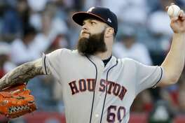 Houston Astros starting pitcher Dallas Keuchel throws against the Los Angeles Angels during the first inning of a baseball game in Anaheim, Calif., Friday, July 20, 2018. (AP Photo/Chris Carlson)