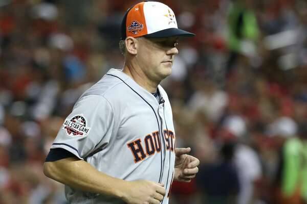 WASHINGTON, DC - JULY 17: Manager A.J. Hinch #14 of the Houston Astros and American League runs off the field after making a pitching change in the fourth inning against the National League during the 89th MLB All-Star Game, presented by Mastercard at Nationals Park on July 17, 2018 in Washington, DC.  (Photo by Rob Carr/Getty Images)