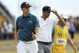 Jordan Spieth of the US, left, and Kevin Chappell of the US finish the third round of the British Open Golf Championship in Carnoustie, Scotland, Saturday July 21, 2018. (AP Photo/Peter Morrison)