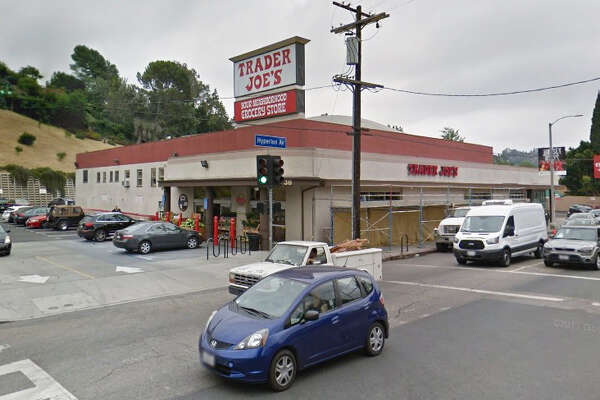 A large number of police surrounded the Trader Joe's in the 2700 block of Hyperion Ave in Los Angeles, California on Saturday, July 21, 2018, after reports of possible gunshots. Views from TV helicopters show people leaving through the front door with their hands up, and crawling out of a window.