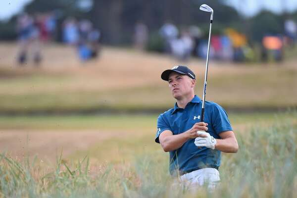 US golfer Jordan Spieth watches his shot played from the rough on the 18th hole during his third round on day 3 of The 147th Open golf Championship at Carnoustie, Scotland on July 21, 2018. / AFP PHOTO / Andy BUCHANANANDY BUCHANAN/AFP/Getty Images