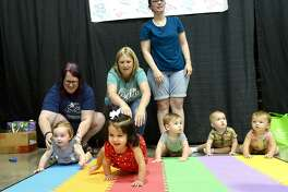From left, babies Adelida Bean, Gracie Livermore, Lily Fitzer, Jaxson Marsh and Carly Villalobos compete in the Diaper Derby at the Baby and Family Expo at the Civic Center. A number of vendors, informational booths, snacks and children's activities rounded out the show for families. Saturday, July 21, 2018 Kim Brent/The Enterprise